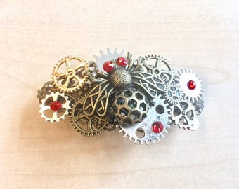 Steampunk hair clip with insect, metal wheels and blue Swarovski rhinestones
