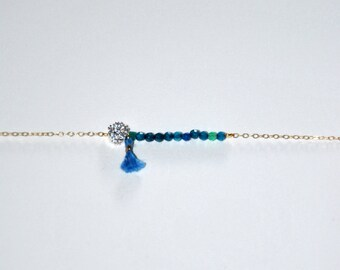 Gold plated bracelet very fine with blue pearls and blue silk tassel
