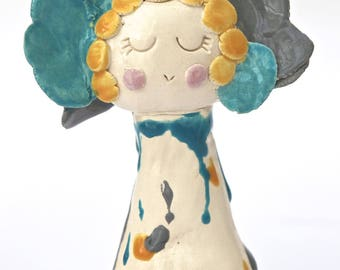 Ceramic lady with grey, blue and yellow hair