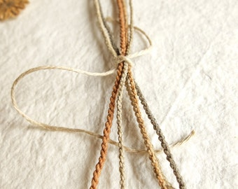 Samples; handmade strings; hemp ropes; linen ropes; waxed threads; strings dyed with onion; jewelry wires.