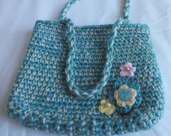 Handbag - crocheted in acrylic yarn - turquoise, pink and yellow - striped cotton lining - flower embellishments - 2 twisted yarn handles.