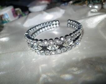 Vintage 1950s  silvertone clear rhinestone bangle bracelet
