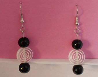 Black bead and white circle bead with silver fishhook