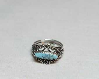 scrollwork adjustable ring with turquoise colored stone
