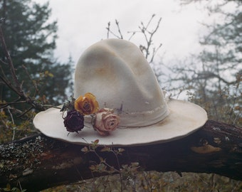 A white hat to rest them dead flowers
