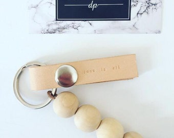 Leather key chain with natural wooden beads (love is all)