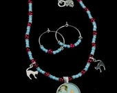 Sky Blue and Red Alice in Wonderland Grin Without A Cat Necklace And Earrings Set