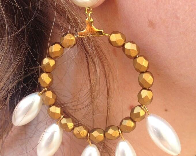 Hoop earrings and white beads