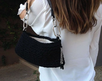 Black knit, lined purse w/ dangle charm