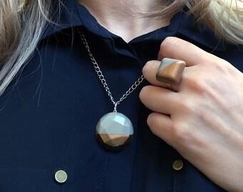 Old copper geometric concrete necklace