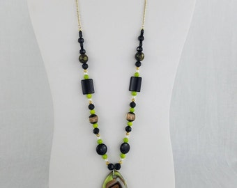 Green, black and Gold Necklace with glassswirl Pendant