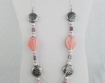 2 strand coral colored necklace with chain
