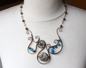 Unique Art Nouveau Steampunk Necklace with watch pendant, blue glass beads and wire frame handmade with love