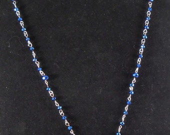 Deep royal blue faceted bead chain with druzy focal.
