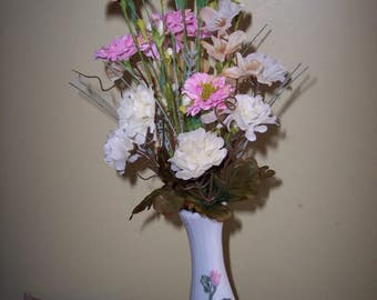 Small floral vase with pink carnations