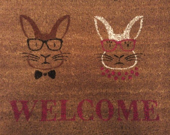 Coconut doormat welcome with two rabbits