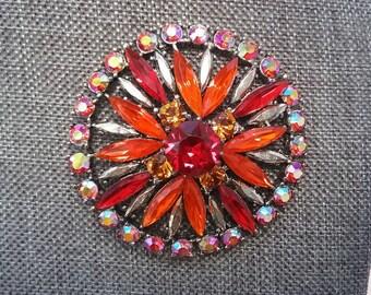 aurora and orange round brooch