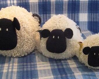 Sheep tea cosies