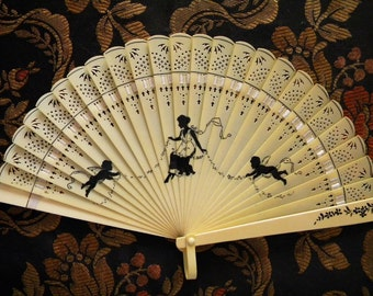 Antique Celluloid Fan with Black Silhouette of Woman and Cupids on Ivory
