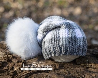 Newborn knit slouch hat in gray and white check with oversized faux fur pom