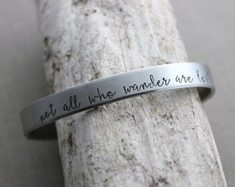 not all who wander are lost, Hand stamped aluminum bracelet, 1/4 Inch Bangle Silver tone Cuff Bracelet, Lightweight, Traveler - wanderer