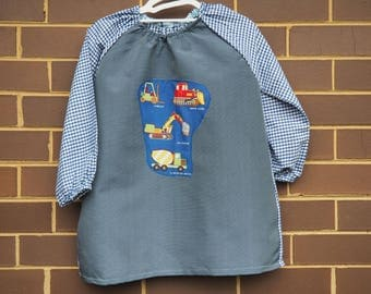 Back to school kids art smock, long sleeve waterproof front craft apron. Fits age 5 to 8. Grey blue with construction motif.