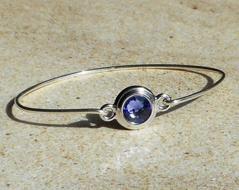 Clasping Sterling silver bangle with tanzanite violet blue Swarovski  crystal in silver plated bezel