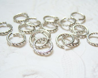 12 - Antiqued silver plated 9mm fancy etched jump rings - HB108