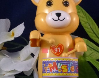 Vintage Wind Up Toy Yellow Bear Playing Drum, 1995