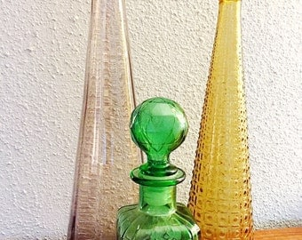 Vintage Italian Green pressed glass decantur with geodesic stopper.