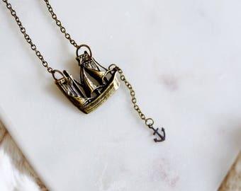 seven seas. a nautical ship and anchor necklace