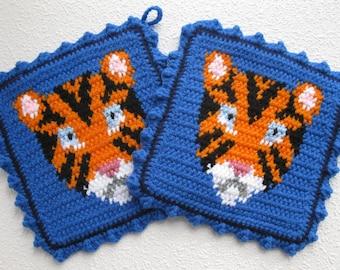 Tiger Pot Holders.  Large, blue, tapestry crochet potholders with tigers. Animal trivet