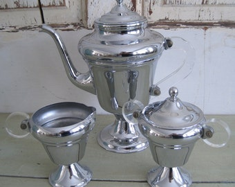 1950s art deco chrome coffee server and creamer and sugar clear lucite handles