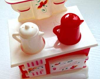 Fantastic Hard Plastic Stove Salt and Pepper Shakers with Sugar Container