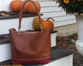 Leather Bag with Brown Leather Upper and Ticking covered in Vinyl Bottom