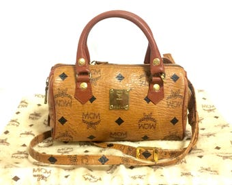 Vintage MCM classic brown monogram mini speedy bag with shoulder strap. Must have purse, designed by Michael Cromer.