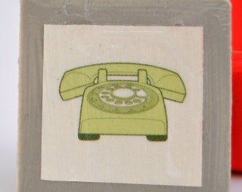 Tile magnet with green retro rotary telephone vintage on grey background