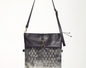 ÉTINCELLE - leather messenger bag, foldable - black with deconstructed silkscreen like edgy and grunge