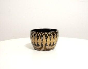 Black geometric and striped stoneware bowl