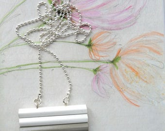 Long wooden necklace with colored pencils in white, grey and black