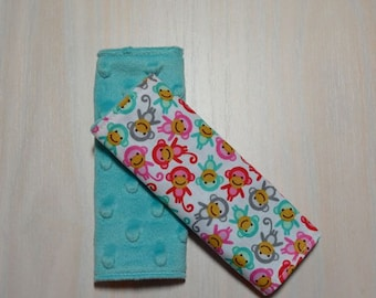 Car Seat Strap Covers - White w/ small monkeys, pink, turquoise