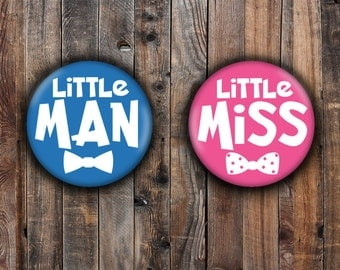 Little Miss and Little Man gender reveal pins.  Blue and Pink background.