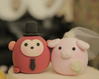 pig and monkey wedding cake topper