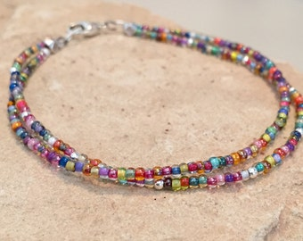 Multicolored seed bead bracelet made with Toho seed beads, sterling silver round and cube beads with a sterling silver trigger clasp