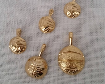 Gold Electroporated Charms of Either Basketball or Volleyball.