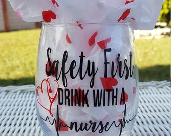 Safety first drink with a nurse, nurse gift, nurses week gifts, nurse wine glass, nursing gifts, gifts for her, wine gifts, nursing school