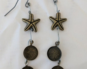 Gold starfish drop earrings with wire filigree