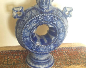 Unusual blue glazed little bottle with a hole through the middle ornate home decor boho gypsy vintage kitsch