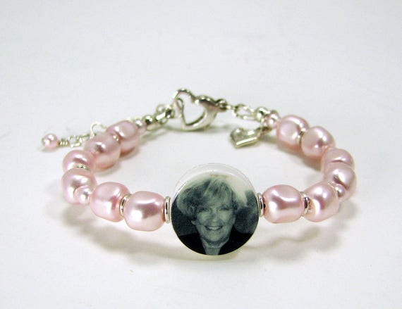 A Child's Pink Pearl Bracelet, A Photo Charm and Sterling Heart Charm -C8aB3