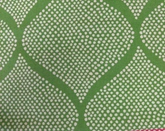 Modern polka dots in a geometric pattern.  Shown in a bright green, the perfect choice   for your cottage home. Pairs well with  bright pink
